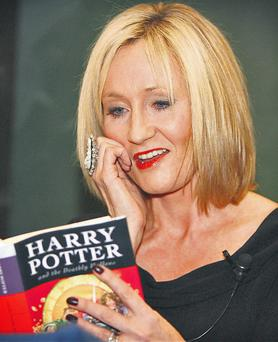 Harry Potter may not be finished after all. Author JK Rowling, pictured by Frank McGrath, in Dublin last night, hinted there could be more of the child wizard's adventures in coming years