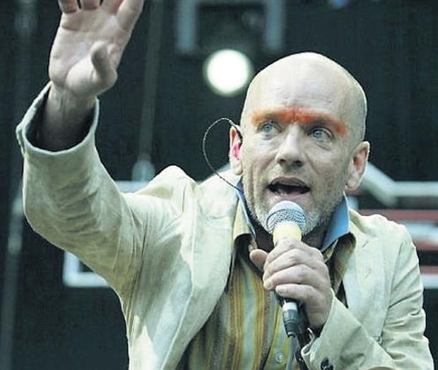 Michael Stipe and his REM bandmates will play the festival, which regularly pulls in 80,000 fans, on July 12