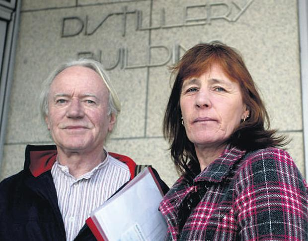 Kathy O'Beirne, whose allegations of sexual abuse against her late father in her autobiography, 'Kathy's Story', upset her siblings, with writer Michael Sheridan outside the HIgh Court