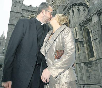 Dean Dermot Dunne kisses his wife Celia outside Christ Church cathedral yesterday