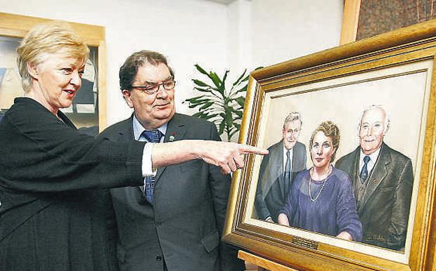 Thinking big: Nora Herlihy's niece Marian Finucane and Nobel Laureate John Hume unveil artist Jim Harkin's portrait last night