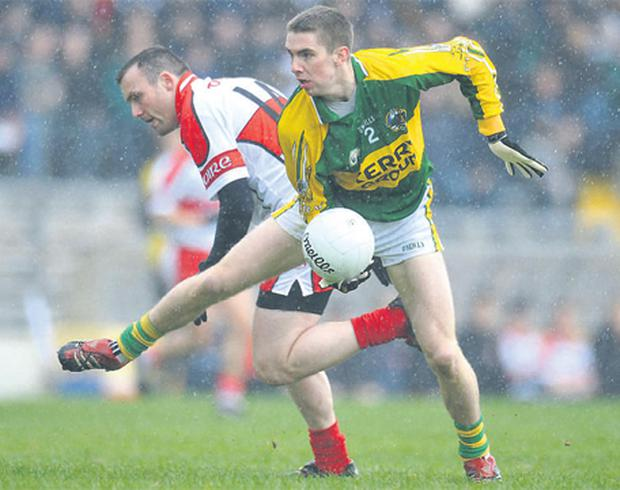 Marc O Se of Kerry evades the challenges of Derry's Paddy Bradley during their National Football League clash in Killarney