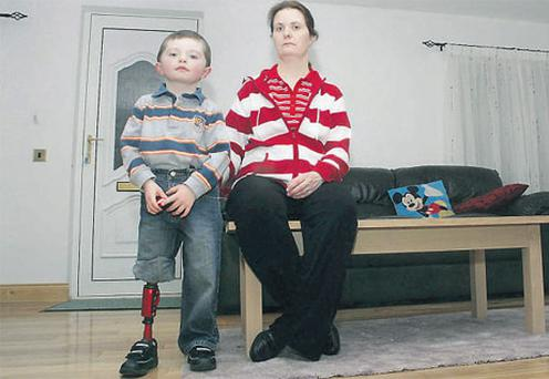 Sonia Breen, of Railway View, Roscrea, Co Tipperary with her son Kieran, who has a prosthetic leg