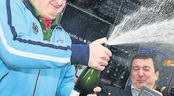GOOD CALL: Philip Cosgrave celebrates with Mark Gould of O2 outside the shop on Grafton Street after he picked up the first iPhone