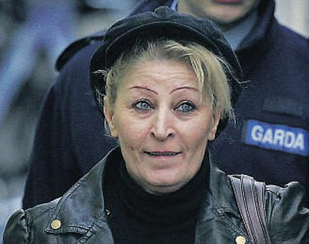 Kathleen Mulhall, mother of the 'Scissor Sisters', faces 11 charges in connection with the murder of her boyfriend