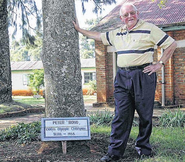 Brother Colm O'Connell at the tree dedicated to Peter Rono at Patrick's High School in the Rift Valley town of Iten