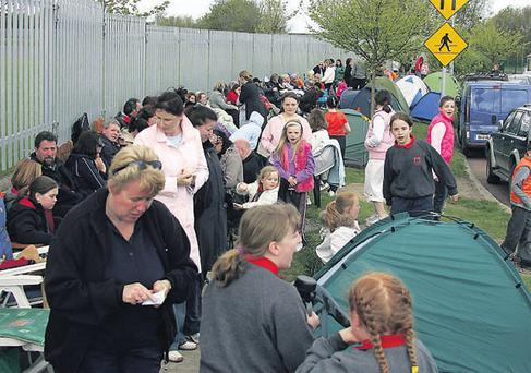 Parents and pupils queue outside the Loretto Convent in Swords to enrol in the 120 places available in local schools in this 2006 file image. Almost three quarters of parents believe they should have the right to choose from a variety of publicly-funded schools