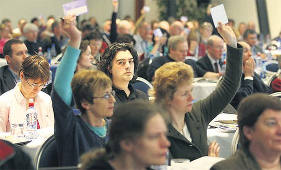 Delegates participate in a debate during the last day of the TUI annual conference in Wexford yesterday