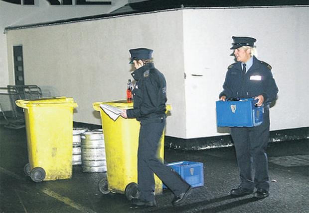 Gardai removing stock from the Golden Grill nightclub in Letterkenny on Saturday night