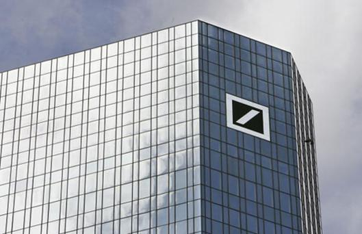 The headquarters of Deutsche Bank AG, Germany's biggest bank. Deutsche Bank AG said today it expects to book about 2.5 billion euros ($3.9 billion) in writedowns for the quarter.