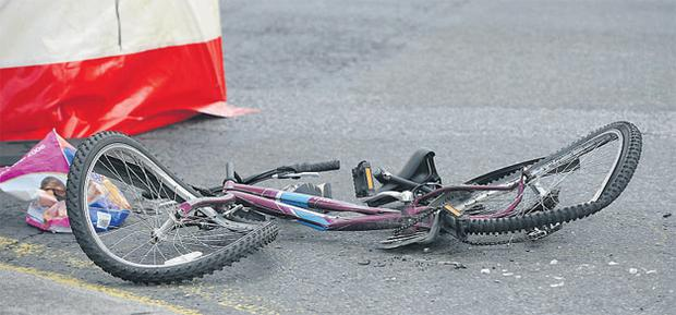 The crumpled bicycle (above) at the scene of the accident in which a cyclist was killed yesterday