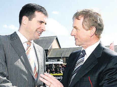 Royston Brady (left) and Enda Kenny catch up