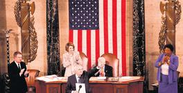 CREST OF A WAVE: Bertie Ahern waves to the Joint Houses of Congress in the House of Representatives in Washington, watched by Speaker of the House Nancy Pelosi and the president pro tempore of the Senate Robert Byrd