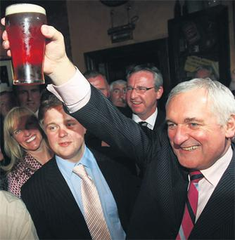 Bertie Ahern enjoys a pint of Bass with friends and supporters in Fagan's pub, Drumcondra, Dublin last night