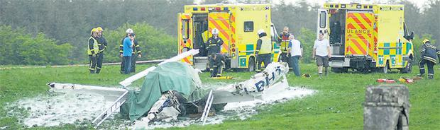 Emergency crews sift through the wreckage of the plane that crashed on the Mayo-Roscommon border