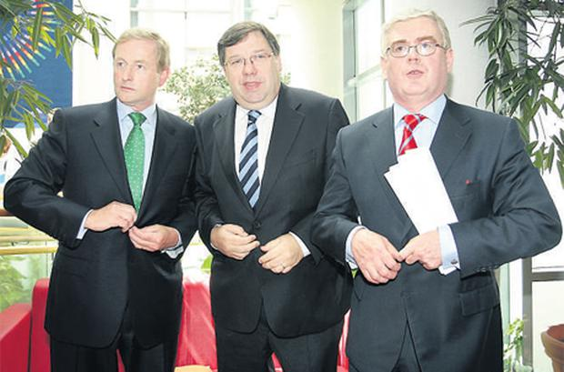 Fine Gael leader Enda Kenny, Taoiseach Brian Cowen and Labour Party leader Eamon Gilmore are in unison as they prepare for a joint press conference urging a 'Yes' vote on the Lisbon Treaty at the National College of Ireland at the IFSC in Dublin