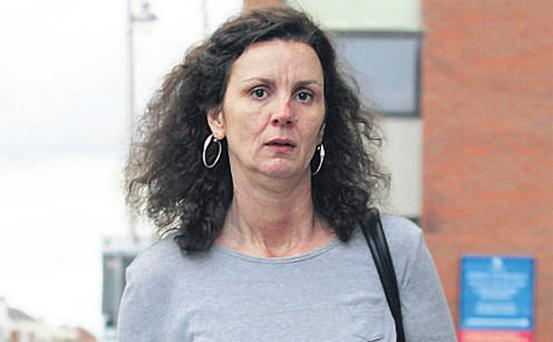 Teresa Engle leaving court yesterday after giving evidence in a trial involving Sharon Collins and Essam Eid on charges of conspiracy to murder kill PJ Howard and his sons Robert and Niall.