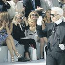 Karl Lagerfeld takes applause after his Fall-Winter 2008-09 Haute Couture collection for Chanel in Paris