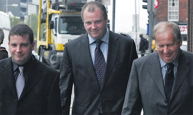 Niall, Robert and PJ Howard leaving the court where Sharon Collins denied the charge of conspiracy to murder the three Ennis businessmen