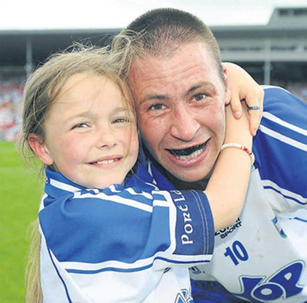 Waterford's Dan Shanahan celebrates with his daughter Chloe ( 9) after his side's victory over Wexford at Semple Stadium, Thurles, yesterday