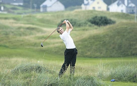 Seamus Power of West Waterford tees off on the 18th at Lahinch Golf Club during the South of Ireland Amateur Open yesterday