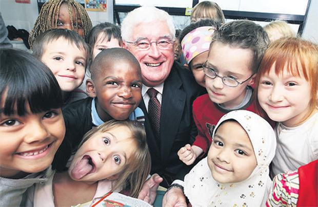 Education Minister Batt O'Keeffe has some fun with the pupils as he opens Lucan East Educate Together NS at Griffeen, Lucan, Co Dublin, yesterday