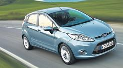 Ford's new Fiesta boasts a stylish new body, plenty of verve and is on its way here next month. The flash exterior is matched by a futuristic interior, incorporating a hi-tech entertainment system