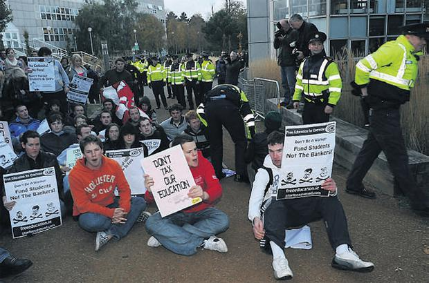 Students hold a protest at an entrance to UCD before Finance Minister Brian Lenihan arrived last night