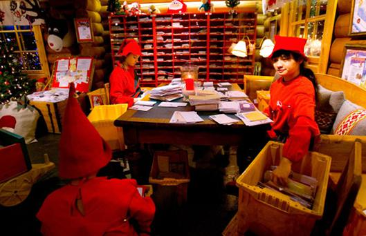 Elves sort through letters at the Santa Claus Main Post Office in Lapland. Photo: Getty Images