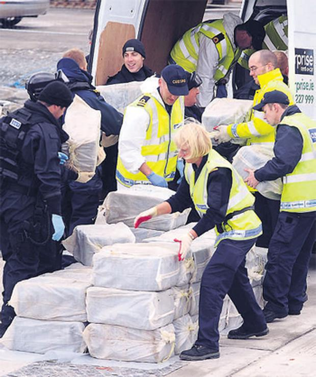 Customs and Navy officers load cocaine bales into a van yesterday after they were removed from the yacht 'Dances with Waves' in Castletownbere, Co Cork