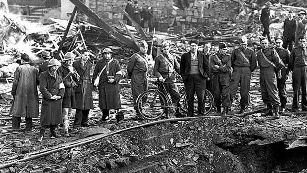 Shocked residents and members of the Local Defence Force sift through shell-damaged homes and gather around a crater left after Luftwaffe planes dropped German shells on North Strand in Dublin in 1941