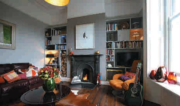 The more formal front sitting room has funky touches, such as the animal-skin rug from Duff Tisdall, Taney Road, Goatstown