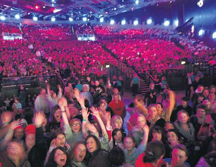 Music fans get in the mood during last night's Childline Concert at the O2 in Dublin where Eoghan Quigg was among the many stars on stage for the first show at the re-opened venue.