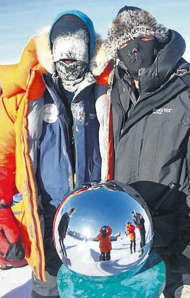 Mark 'on the sphere' at the ceremonial marker for the South Pole with race organiser Tony Martin