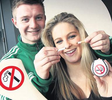 Galway hurling star Joe Canning and student Enya Farrell . The hurler reminded students that smoking inhibits sports players' ability to excel.