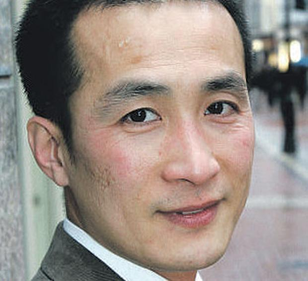 Tortured: Falun Gong follower Ming Zhao who now lives in Dublin. Picture by Ronan Lang