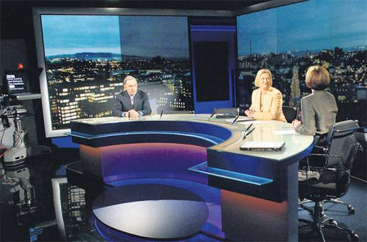 Colm Murray, Eileen Dunne and Una O'Hagan during rehearsals in the new RTE news studio yesterday