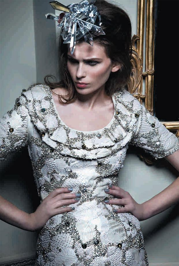 Silk dress with double-frilled neck, hand-embellished crystals, applique work and hand-sewn lace embroidery, €1,400; crystal crown, to order