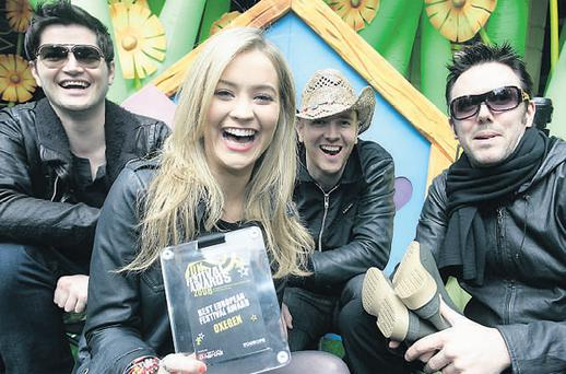 MTV VJ Laura Whitmore having a laugh yesterday with Irish band The Script to launch this year's Oxegen 2009. Whitmore will host the re-broadcast of Oxegen '09 while The Script are among the bands on the bill. Tickets are on sale today