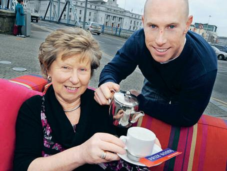 Ah go on, go on... Rugby star Peter Stringer pours tea for his mother Aileen at the launch of the €1m Prize Bond draw on March 27, just after Mother's Day.