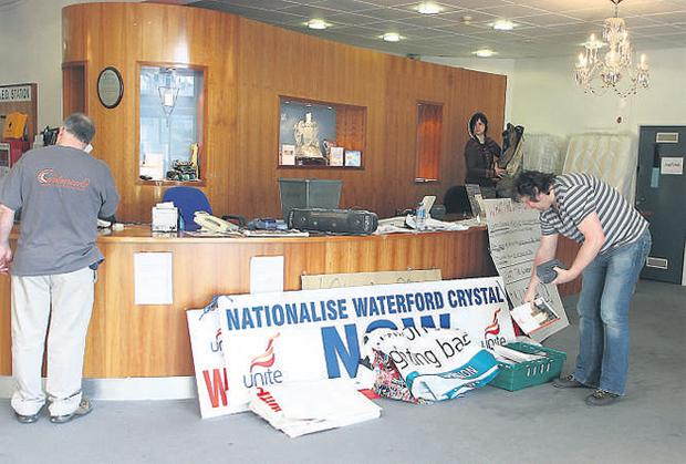 Workers clear up at the Waterford Crystal visitor centre after their sit-in ended earlier this week