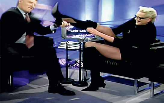 Putting the boot in: Pat Kenny with Brigitte Nielsen on The Late Late Show. Below, Gay Byrne kisses singer Sinead O'Connor during his tenure on the Late Late