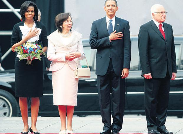 President Obama and wife Michelle listen to the national anthem with Czech President Vaclav Klaus and his wife Livia Klausova.