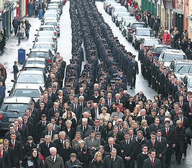 The cortege moves through Swinford at the State funeral of Garda Robert McCallion yesterday
