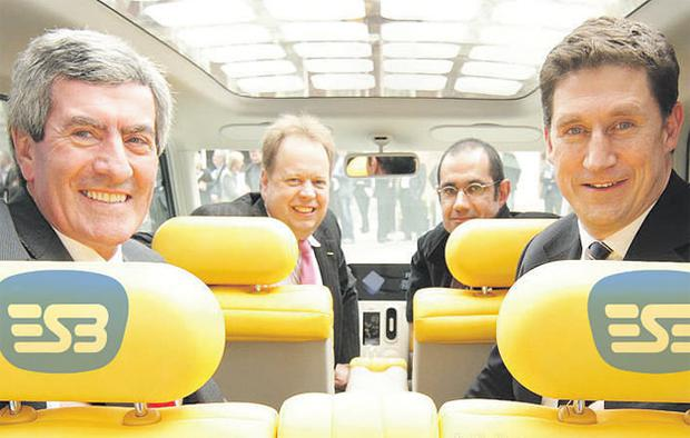 Sitting in the 'Denki Cube' electric concept car are ESB chief executive Padraig McManus with Energy Minister Eamon Ryan, in the front seat from left to right, are Andrew Palmer, corporate vice president Nissan and Thierry Koskan programme director (electric cars) of Renault