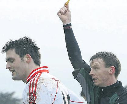 Derry's Eoin Bradley gets a yellow card from referee Joe McQuillan in the early rounds of the league - if the GAA really wants to improve the position of referees and bring them to the same level of respect as rugby, they should start with under-age games right now
