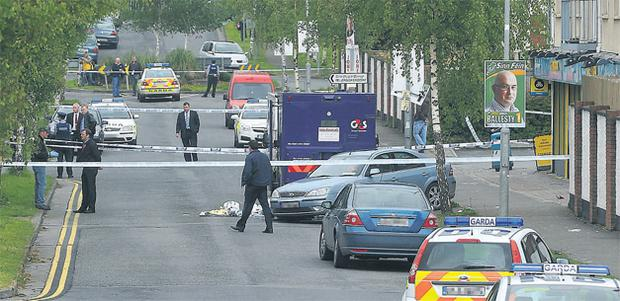 The scene at Foxborough Road in Lucan, West Dublin, yesterday where two men were shot by gardai, one fatally, while attempting an armed raid on a cash-in-transit van