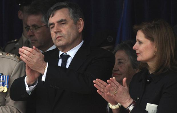Britain's Prime Minister Gordon Brown and his wife Sarah watch as D-Day veterans take part in the Normandy Veterans Final Salute. Photo: Matt Cardy/Getty Images