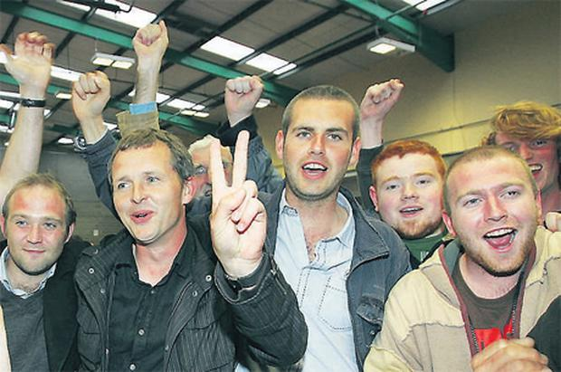 Richard Boyd Barrett (second from left) of the People Before Profit Alliance being congratulated by supporters, including fellow candidate Hugh Lewis (in blue shirt denim jacket), at the weekend