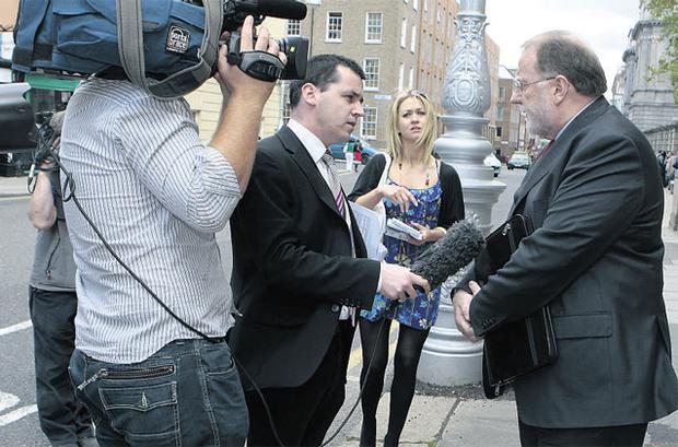 RTE's director general Cathal Goan talks to the media after his briefing before an Oireachtas committee yesterday. Photo: TOM BURKE